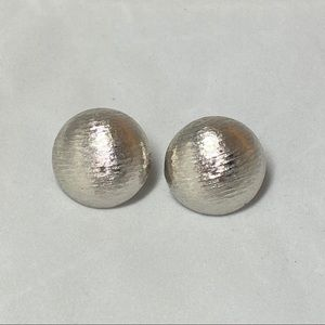 Vintage Monet silver tone round clip on earrings